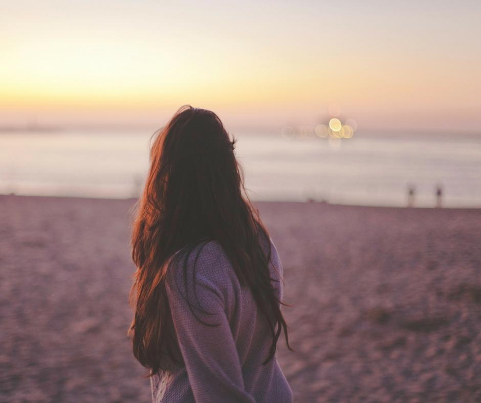 Woman walking on beach (not a skank)